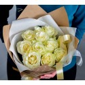Bouquet of 11 white roses in a package