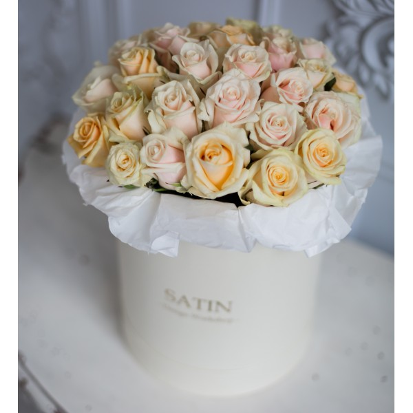 Box of cream roses