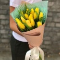 Bouquet of 15 yellow tulips in craft packaging